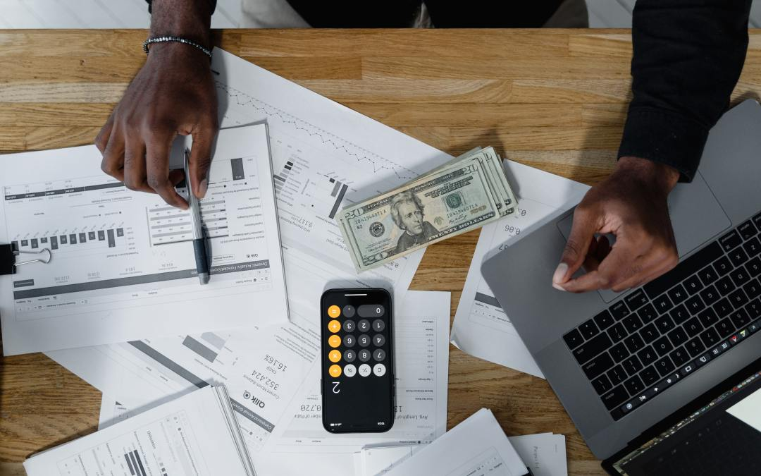 Destiny Capital - Image of a man working on his finances at his desk